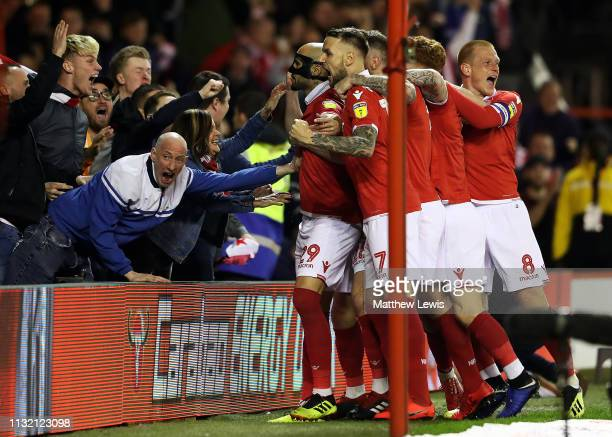 Yohan Benalouane of Nottingham Forest is congratulated on his goal during the Sky Bet Championship match between Nottingham Forest and Derby County...