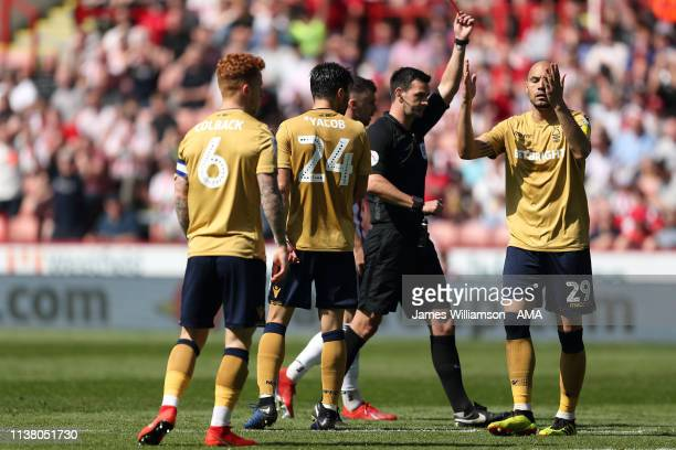 Yohan Benalouane of Nottingham Forest is shown a Red Cad by match referee Andrew Madley during the Sky Bet Championship fixture between Sheffield...