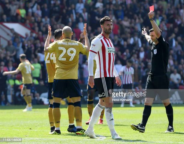 Yohan Benalouane of Nottingham Forest is shown a red card by referee Andrew Madley during the Sky Bet Championship match between Sheffield United and...