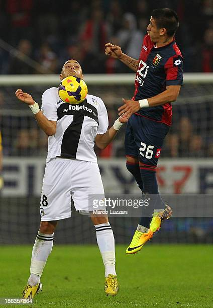 Yohan Benalouane of Parma FC competes for the ball with Ricardo Centurion of Genoa CFC during the Serie A match between Genoa CFC and Parma FC at...