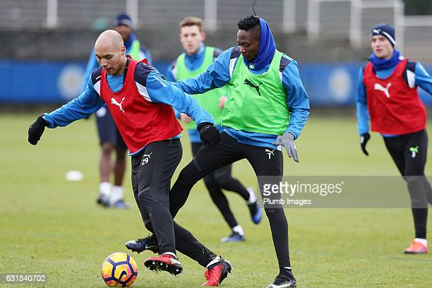 Yohan Benalouane under pressure from Ahmed Musa during the Leicester City training session at Belvoir Drive Training Complex on January 12 2017 in...