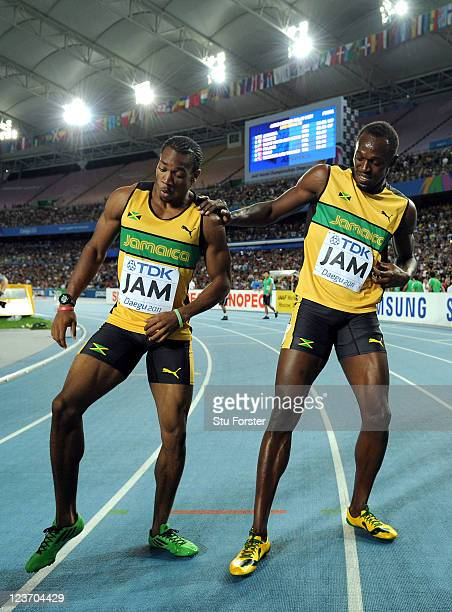 Yohan Blake and Usain Bolt of Jamaica celebrate victory and a new world record in the men's 4x100 metres relay final during day nine of 13th IAAF...
