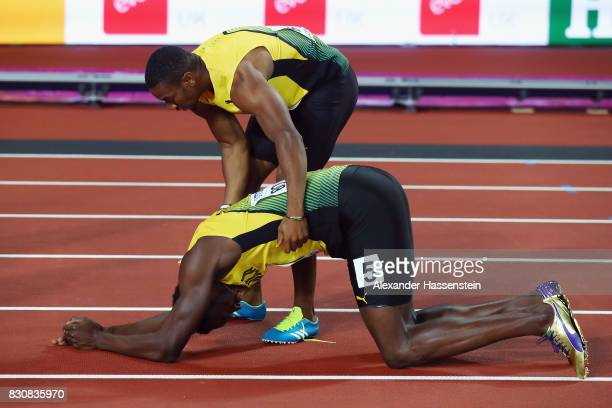 Yohan Blake checks on Usain Bolt of Jamaica after Bolt fell in the Men's 4x100 Relay final during day nine of the 16th IAAF World Athletics...