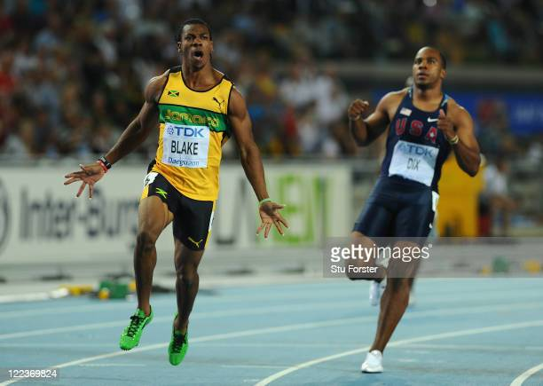 Yohan Blake of Jamaica celebrates winning the men's 100 metres final ahead of Walter Dix of United States during day two of the 13th IAAF World...