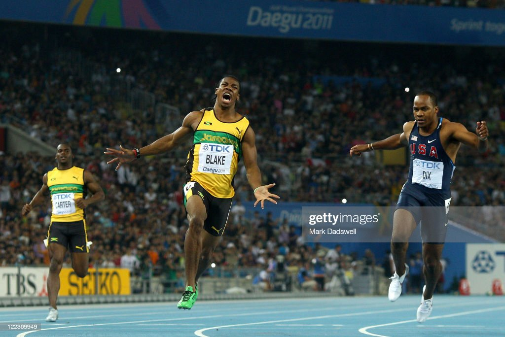 Yohan Blake (C) of Jamaica celebrates winning the men's 100 metres final ahead of Walter Dix of United States during day two of the 13th IAAF World Athletics Championships at the Daegu Stadium on August 28, 2011 in Daegu, South Korea.