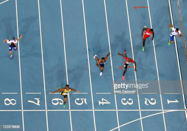 Yohan Blake of Jamaica celebrates winning the men's 100 metres final ahead of Walter Dix of United States and Kim Collins of Saint Kitts and Nevis...