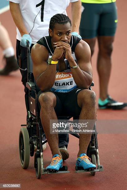 Yohan Blake of Jamaica is led off in a wheelchair after going down with an injury in the Mens 100m final during the IAAF Diamond League Day 1 at...