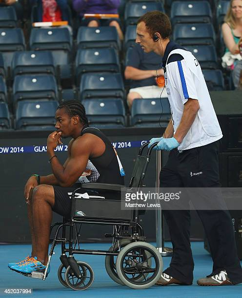 Yohan Blake of Jamaica is wheeled off in a wheelchair after pulling up in the Mens 100m Final with a hamstring injury during day one of the Diamond...