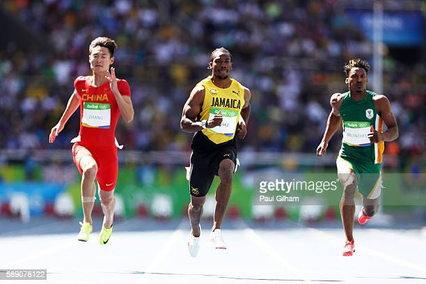 Yohan Blake of Jamaica Peimeng Zhang of China and Henricho Bruintjies of South Africa compete in the Men's 100m Round 1 on Day 8 of the Rio 2016...