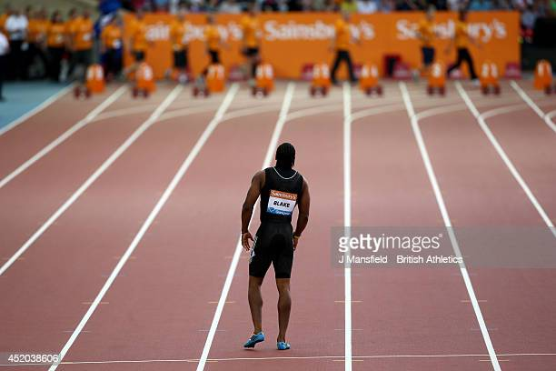 Yohan Blake of Jamaica walks off the track after going down with an injury in the Mens 100m final during the IAAF Diamond League Day 1 at Hampden...