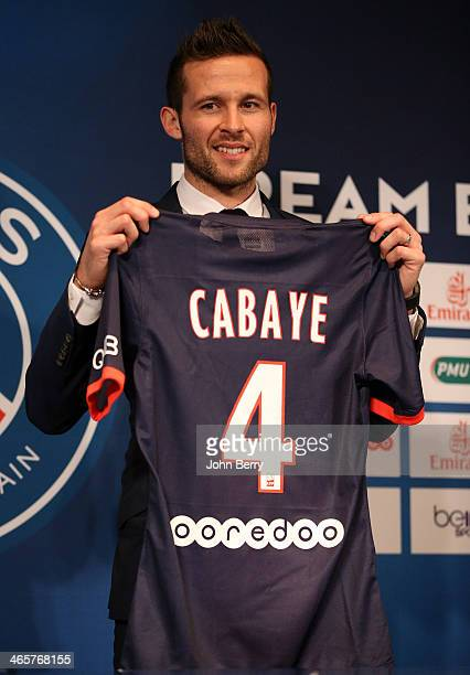 Yohan Cabaye is presented by Nasser Al-Khelaifi, president of Paris Saint-Germain as a new player of PSG during a press conference with a jersey...