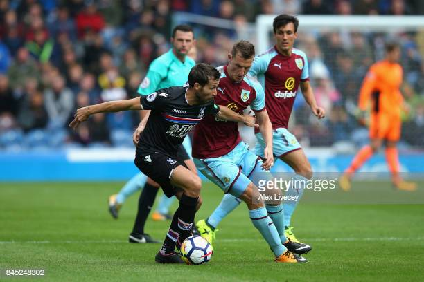 Yohan Cabaye of Crystal Palace and Chris Wood of Burnley in action during the Premier League match between Burnley and Crystal Palace at Turf Moor on...