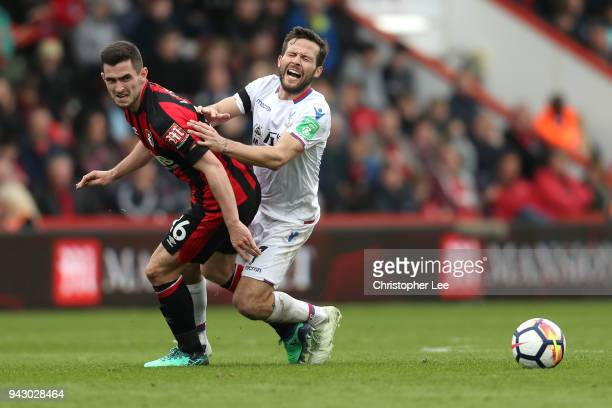 Yohan Cabaye of Crystal Palace and Lewis Cook of AFC Bournemouth battle for the ball during the Premier League match between AFC Bournemouth and...