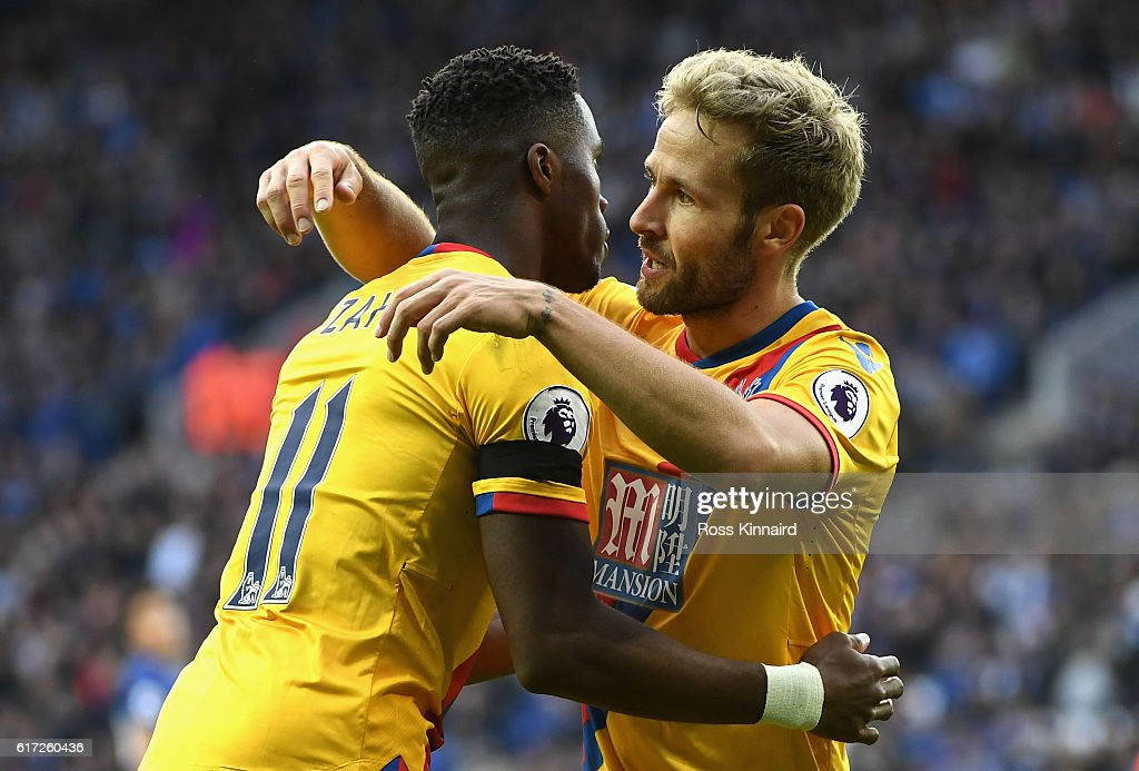 Yohan Cabaye of Crystal Palace (R) celebrates scoring his sides first goal with his team mate Wilfried Zaha of Crystal Palace (L) during the Premier League match between Leicester City and Crystal Palace at The King Power Stadium on October 22, 2016 in Leicester, England.