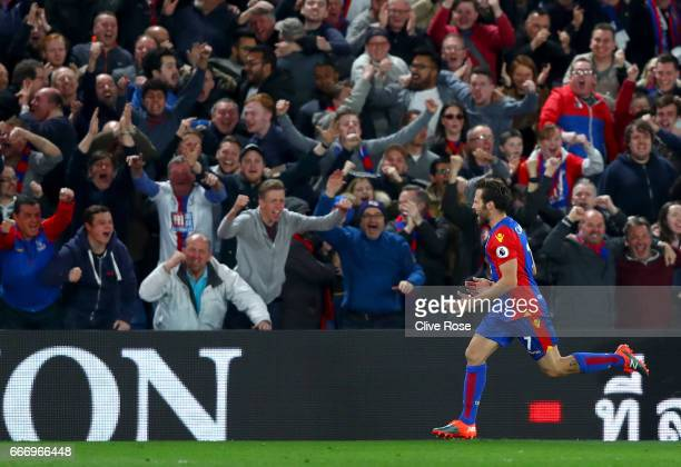 Yohan Cabaye of Crystal Palace celebrates scoring their second goal with fans during the Premier League match between Crystal Palace and Arsenal at...
