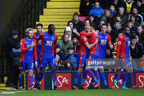 Yohan Cabaye of Crystal Palace celebrates with teammates after scoring the opening goal during the Premier League match between Watford and Crystal...