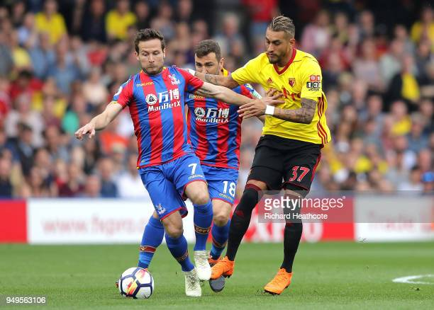 Yohan Cabaye of Crystal Palace is challenged by Roberto Pereyra of Watford during the Premier League match between Watford and Crystal Palace at...