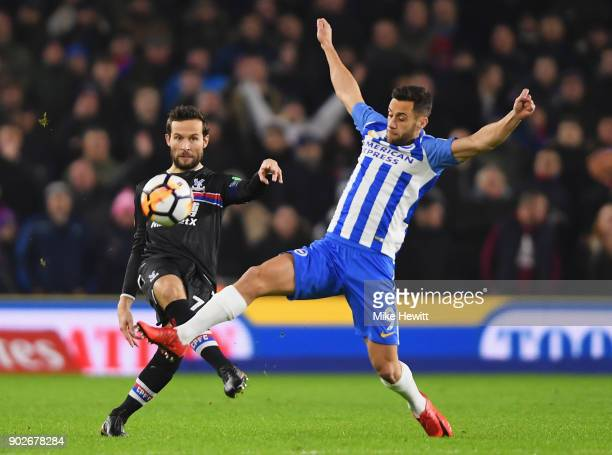 Yohan Cabaye of Crystal Palace is challenged by Sam Baldock of Brighton and Hove Albion during The Emirates FA Cup Third Round match between Brighton...
