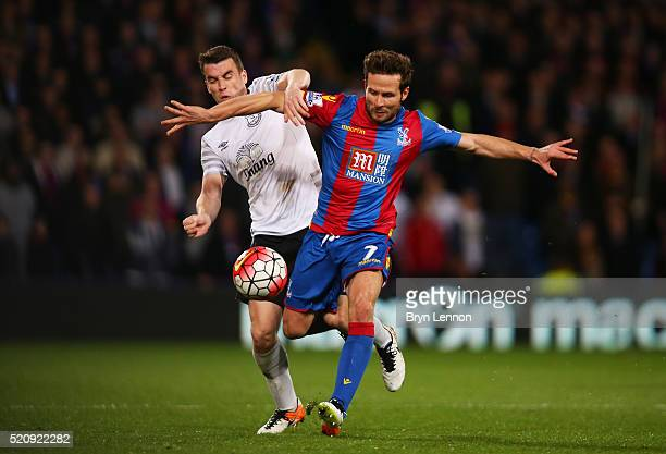 Yohan Cabaye of Crystal Palace is challenged by Seamus Coleman of Everton during the Barclays Premier League match between Crystal Palace and Everton...