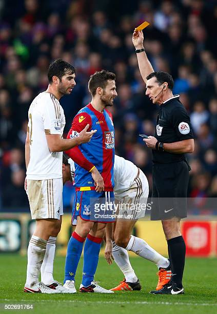 Yohan Cabaye of Crystal Palace is shown a yellow card by referee Neil Swarbrick during the Barclays Premier League match between Crystal Palace and...