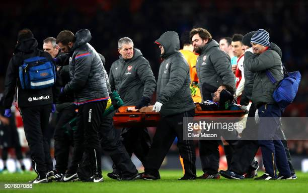 Yohan Cabaye of Crystal Palace is stretchered off injured during the Premier League match between Arsenal and Crystal Palace at Emirates Stadium on...