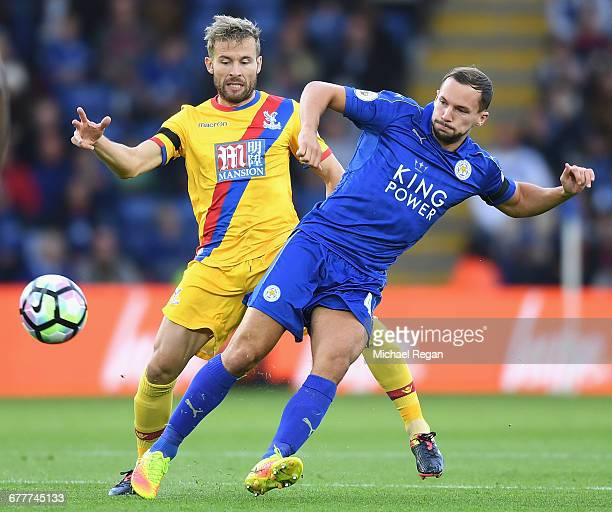 Yohan Cabaye of Crystal Palace puts pressure on Daniel Drinkwater of Leicester City during the Premier League match between Leicester City and...