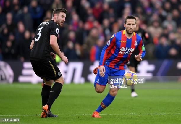 Yohan Cabaye of Crystal Palace runs with the ball away from the pressure of Paul Dummett of Newcastle United during the Premier League match between...