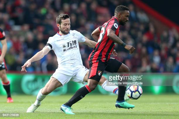 Yohan Cabaye of Crystal Palace stretches round Jermain Defoe of Bournemouth during the Premier League match between AFC Bournemouth and Crystal...