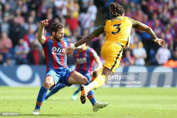 Yohan Cabaye of Crystal Palace tries to catch the leg of Gaetan Bong of Brighton during the Premier League match between Crystal Palace and Brighton...