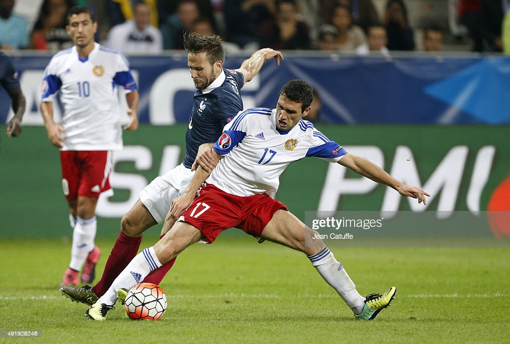 Yohan Cabaye of France and Artur Yuspashyan of Armenia in action during the international friendly match between France and Armenia at Allianz Riviera stadium on October 8, 2015 in Nice, France.