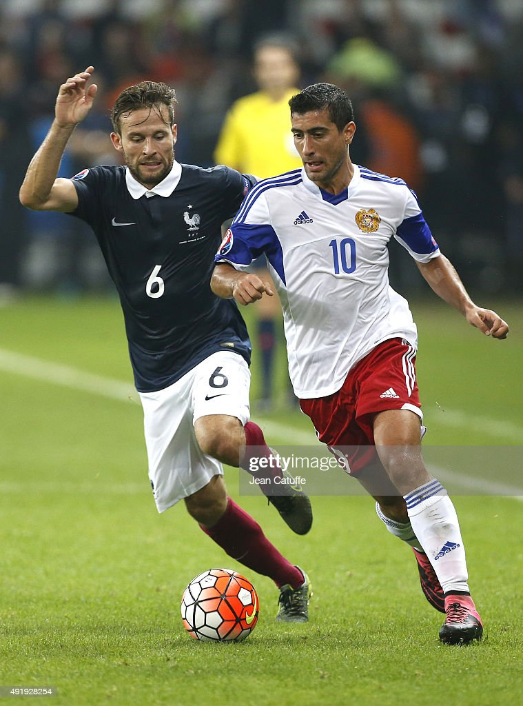 Yohan Cabaye of France and Gevorg Ghazaryan of Armenia in action during the international friendly match between France and Armenia at Allianz Riviera stadium on October 8, 2015 in Nice, France.