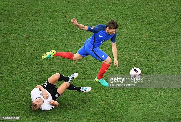 Yohan Cabaye of France battles for the ball with Toni Kroos of Germany during the UEFA EURO semi final match between Germany and France at Stade...