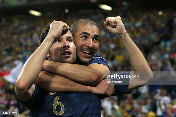 Yohan Cabaye of France celebrates scoring their second goal with Karim Benzema of France during the UEFA EURO 2012 group D match between Ukraine and...