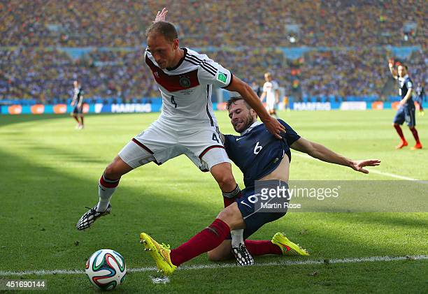 Yohan Cabaye of France tackles Benedikt Hoewedes of Germany during the 2014 FIFA World Cup Brazil Quarter Final match between France and Germany at...