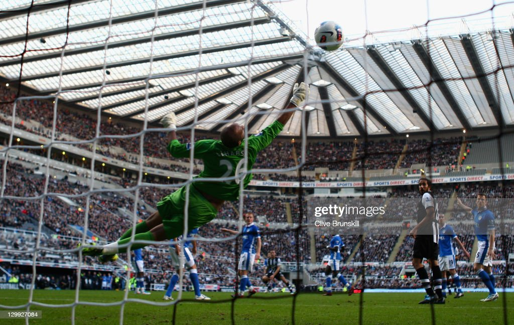Yohan Cabaye of Newcastle United beats Wigan Athletic keeper Ali Al Habsi to score the first goal during the Barclays Premier League match between Newcastle United and Wigan Athletic at St James' Park on October 22, 2011 in Newcastle upon Tyne, England.