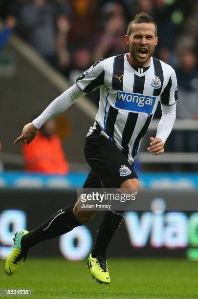 Yohan Cabaye of Newcastle United celebrates scoring their first goal during the Barclays Premier League match between Newcastle United and Liverpool...