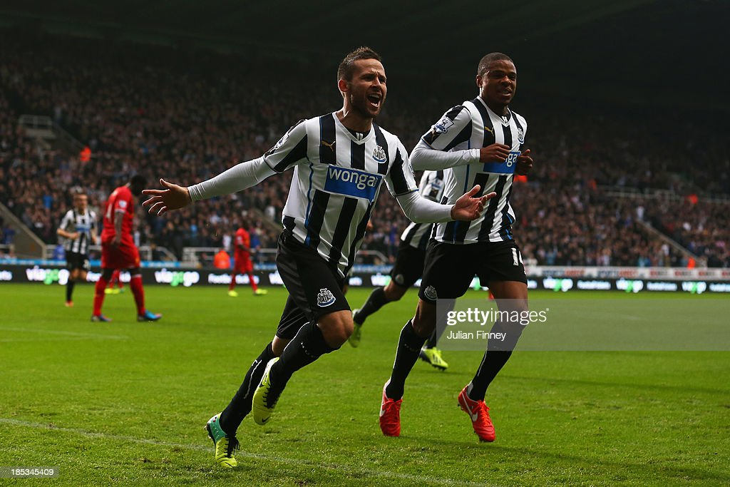 Yohan Cabaye of Newcastle United celebrates scoring their first goal with Loic Remy of Newcastle United during the Barclays Premier League match between Newcastle United and Liverpool at St James' Park on October 19, 2013 in Newcastle upon Tyne, England.