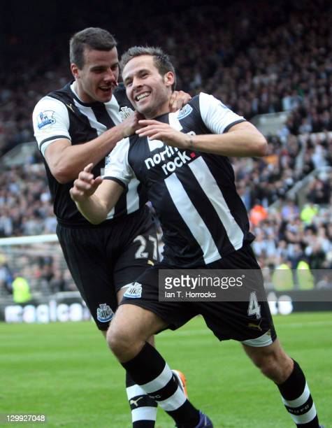 Yohan Cabaye of Newcastle United celebrates with teammate Steven Taylor after scoring the 10 goal during the Barclays Premier League match between...