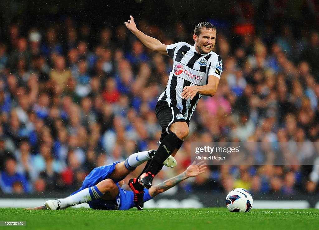 Yohan Cabaye of Newcastle United evades Raul Meireles of Chelsea during the Barclays Premier League match between Chelsea and Newcastle United at Stamford Bridge on August 25, 2012 in London, England.
