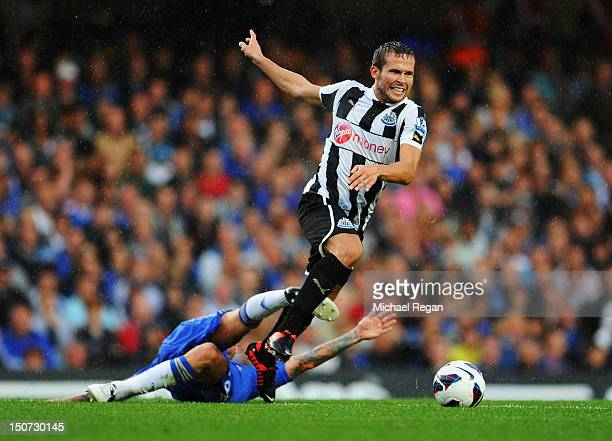 Yohan Cabaye of Newcastle United evades Raul Meireles of Chelsea during the Barclays Premier League match between Chelsea and Newcastle United at...