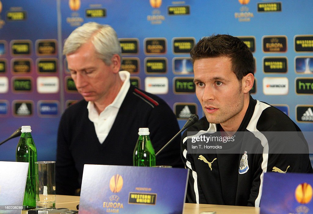 Yohan Cabaye of Newcastle United FC (R) speaks beside manager Alan Pardew during a press conference ahead of their UEFA Europa League round of 32 second leg match against FC Metalist Kharkiv, at Metalist Stadium on February 20, 2013 in Kharkov, Ukraine.