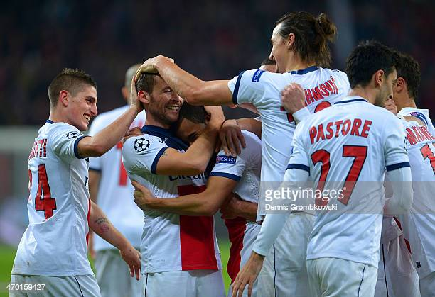 Yohan Cabaye of PSG celebrates with team mates after scoring their fourth goal during the UEFA Champions League Round of 16 first leg match between...