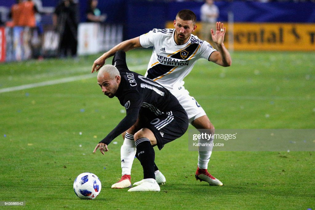 Yohan Croizet #10 of Sporting Kansas City (L) and Michael Ciani #28 of Los Angeles Galaxy fight for control of the ball during a game at StubHub Center on April 8, 2018 in Carson, California.