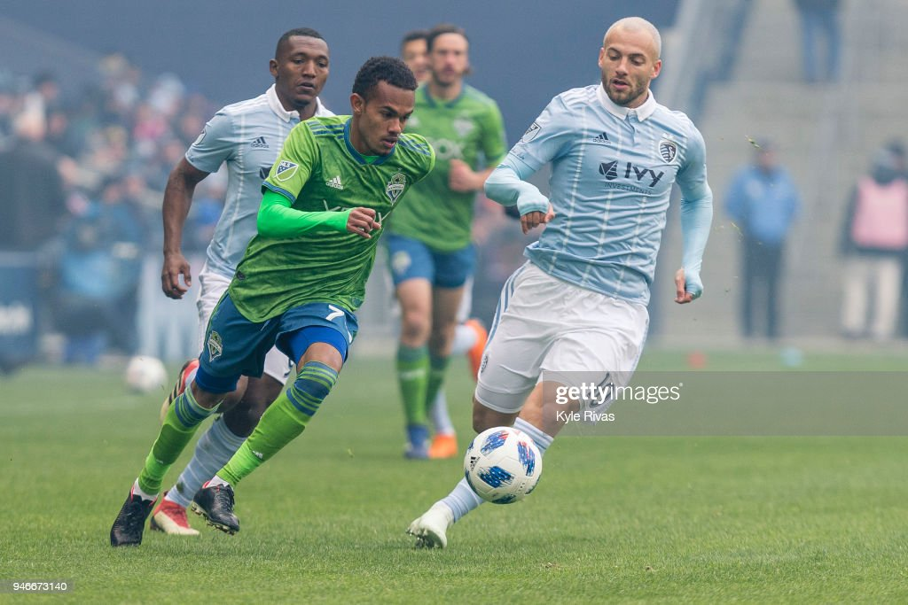 Yohan Croizet #10 of Sporting Kansas City attempts to track down Cristian Roldan #7 of Seattle Sounders in the first half on April 15, 2018 at Children's Mercy Park in Kansas City, Kansas.
