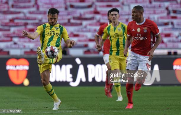 Yohan Tavares of CD Tondela kicks the ball against Carlos Vinicius of SL Benfica during the Liga NOS match between SL Benfica and CD Tondela at...