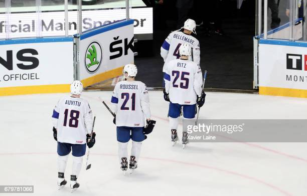 Yohann Auvitu Antoine Roussel Nicolas Ritz and PierreEdouard Bellemare of France are disapointed after the 2017 IIHF Ice Hockey World Championship...