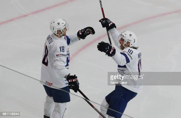 Yohann Auvitu of France celebrate his goal with Laurent Meunier during the 2017 IIHF Ice Hockey World Championship game between Switzerland and...