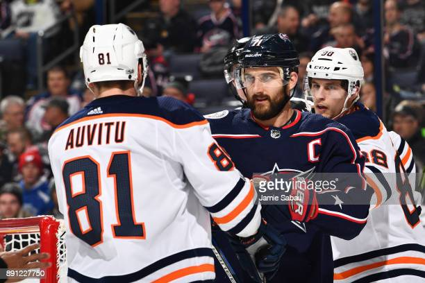 Yohann Auvitu of the Edmonton Oilers and Nick Foligno of the Columbus Blue Jackets pushandshove following a whistle during the first period of a game...
