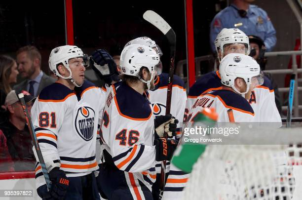 Yohann Auvitu of the Edmonton Oilers celebrates with teammates after scoring a goal during an NHL game against the Carolina Hurricanes on March 20...
