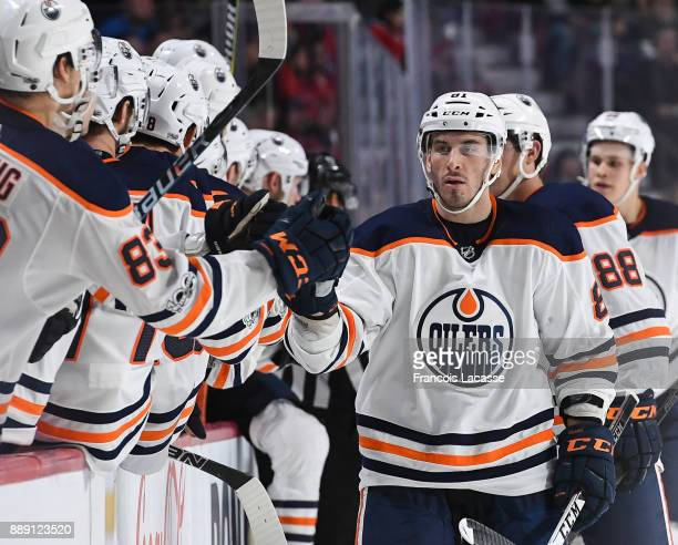 Yohann Auvitu of the Edmonton Oilers celebrates with the bench after scoring a goal against the Montreal Canadiens in the NHL game at the Bell Centre...